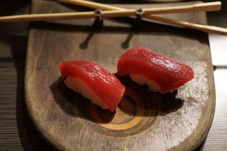 Yellowfin Tuna Nigiri served on the skateboard deck place settings everyone gets at the bar