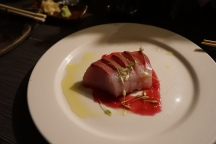 Local Yellowtail Sashimi with Habanero and prickley pear sauce with buddah's hand oil